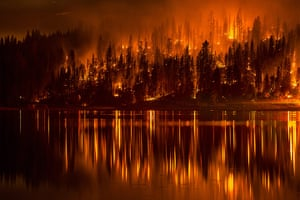 20 photos: A fire approaches the shore of Bass Lake in California