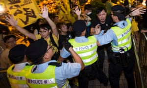 Pro-democracy activists clash with police during a protest outside the hotel where Chinese official Li Fei was staying.