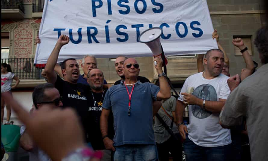 Neighborhood protests such as this one in  La Barceloneta are escalating against mass tourism.
