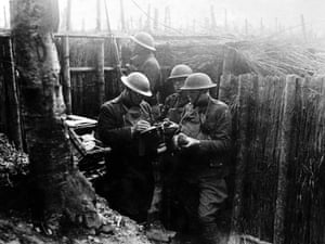 US soldiers in the trenches, with homing pigeons that played a vital role in carrying messages.