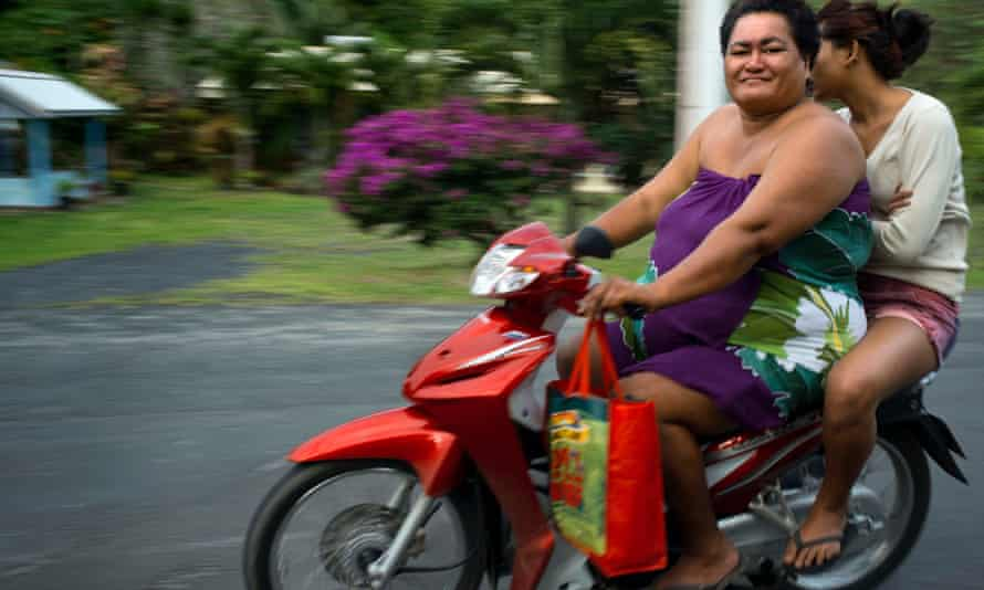 Two obese people drive a motorcycle on a road on the island of Rarotonga, Cook Island, 21 June 2013 . Obesity in the Pacific is a growing health concern with health officials stating that it is one of the leading causes of preventable deaths in the Pacific Rim.