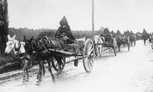 French Moroccan troops head to the front with supply wagons pulled by donkeys.