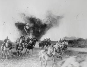 American soldiers score a direct hit on a german gun, scattering horse and soldiers.