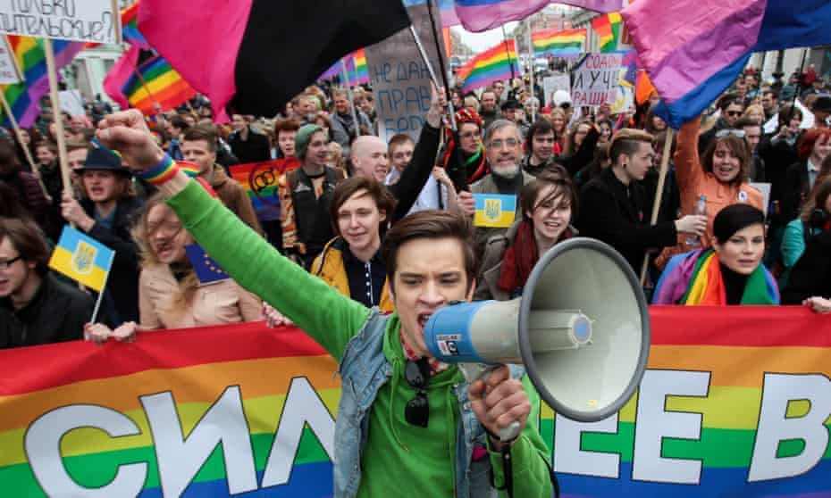 """Gay rights activists on a march in St Petersburg in May. Crimea adopted similar measures to Russia's """"gay propaganda"""" law after it was annexed."""