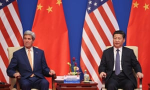 Xi Jinping (right) and US Secretary of State John Kerry. The Chinese president may skip a UN climate meeting in New York