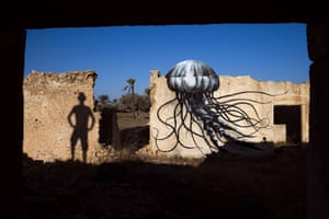 A mural by Belgian artist ROA decorates an abandoned wall in the surrounding area in a village on the Tunisian island of Djerba