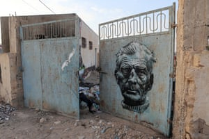Murals by US artist Know Hope and Italian artist Orticanoodles decorate a gate as part of the street art project 'Djerbahood'