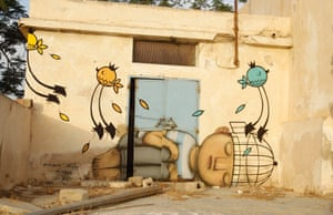 A mural painted by French artist Seth is pictured in the village of Erriadh on Djerba