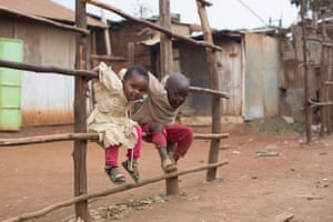 """When they don   t think I   m watching, they do the funniest things. They are always dancing together. I found them in the kitchen yesterday, pretending to cook."" ""What   s your greatest worry as a parent?"" ""Their health. They   re always getting sick from the cold and the dust. Sometimes the dust gets so bad, they lose their voices."" (Nairobi, Kenya)"
