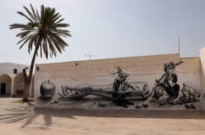 A mural by German artist Dome is part of the street art project 'Djerbahood'