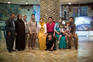 We live in a very conservative culture, but I want my children to be open minded. I try to bring them to as many places as possible: big malls, art galleries, concerts. We want them to see as many types of people as possible, and as many types of ideas as possible.    (Erbil, Iraq)