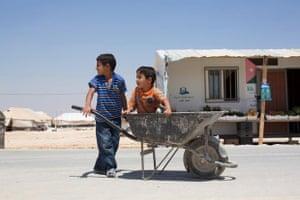 """We're trying to get to Grandma's.""   (Zaatari Refugee Camp, Jordan)"