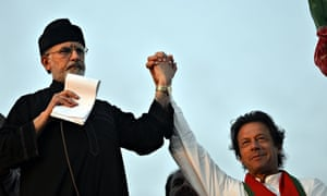 Tahir-ul-Qadri (left) joins hands with Imran Khan during a protest near prime minister's residence