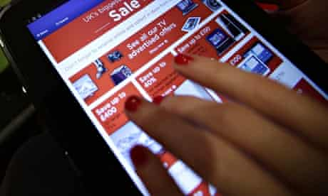 Woman shopping online via a tablet