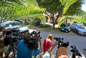 Television journalists stand across from the home of the family of journalist Steven Sotloff, Tuesday, Sept. 2, 2014 in Pinecrest, Fla.
