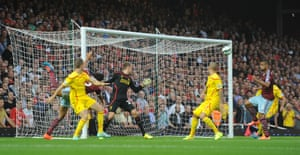 West Ham's Winston Reid scores the first goal in the second minute.