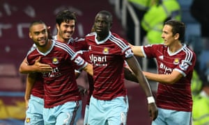 Winston Reid of West Ham is congratulated by teammates after scoring the opening goal.