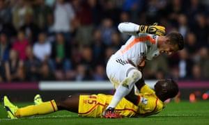 Mario Balotelli and Adrian clash.