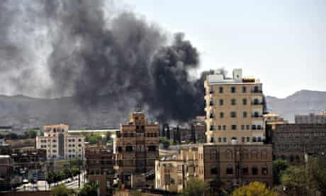 Smoke rises from a Sana'a neighbourhood during fighting on Sunday