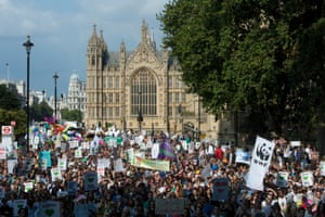 The People's Climate March passes the Houses of Parliament in London
