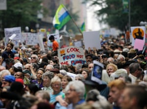 People fill 58th Street between 8th and 9th Avenue in New York before a climate changes protest march