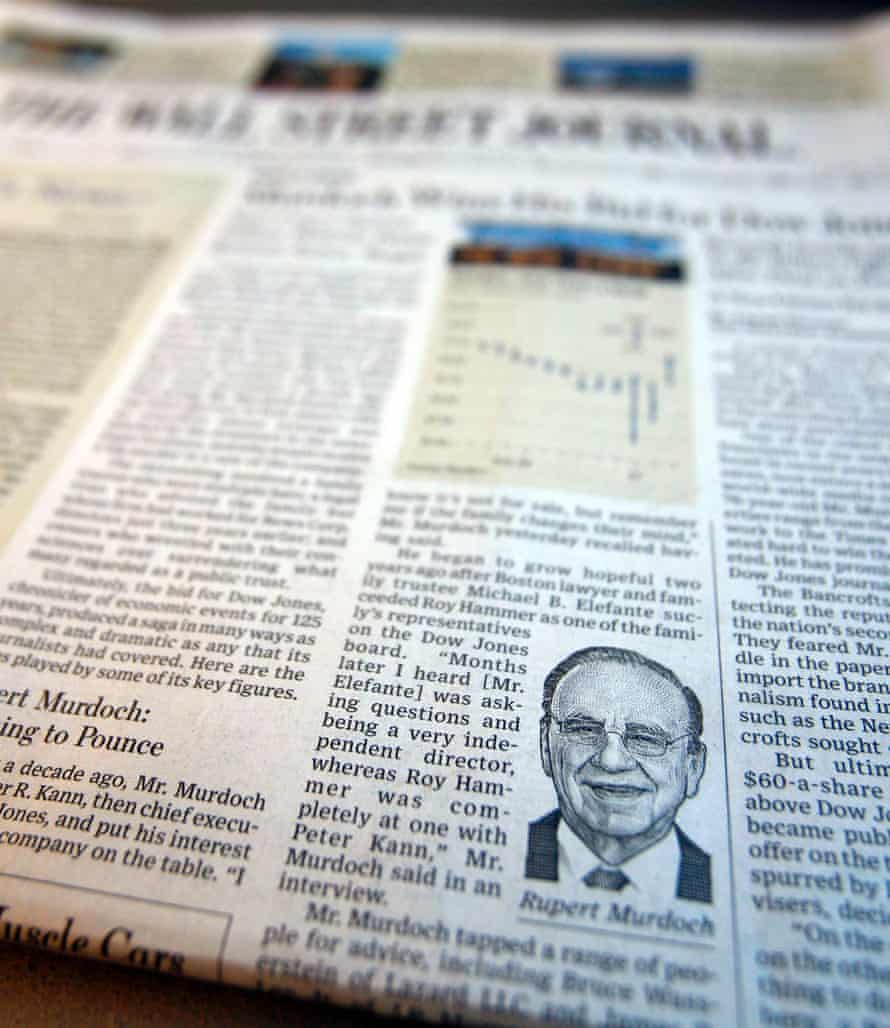 A photograph of the front page of the edition of the Wall Street Journal reporting on Rupert Murdoch's News Corp purchase of Dow Jones & Co.