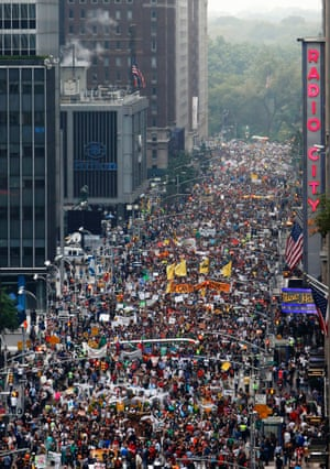 Demonstrators make their way down Sixth Avenue in New York during the People's Climate March Sunday, Sept. 21, 2014.