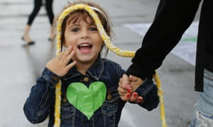 A child smiles during the People's Climate March at Ipanema beach in Rio de Janeiro, Brazil.