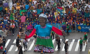 Activists lead with a float while taking part in the People's Climate March through Midtown, New York.