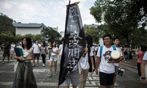 Students carry a banner during the rally at the Chinese University on 22 September in Hong Kong.