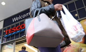 A customer leaves a Tesco Metro supermarket store, operated by Tesco Plc, in London