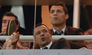 Jorge Mendes, front, watches a Real Madrid game with Cristiano Ronaldo in 2013.