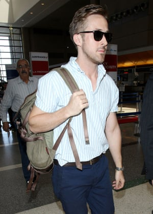 Ryan Goslin wears his backpack, daringly, on one shoulder only.