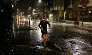 Runner in London street at night