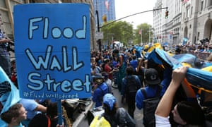 Protestors fill Broadway in lower Manhattan during a rally and protest called 'Flood Wall Street' in New York, New York, USA 22 September 2014.