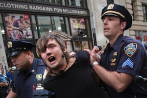 New York City police officers arrest a man taking part in the Flood Wall Street demonstration in Lower Manhattan, New York September 22, 2014.