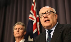 The Attorney-General George Brandis with the new Director General of ASIO Duncan Lewis at a press conference in the blue room of Parliament House in Canberra, Monday 22nd September 2014