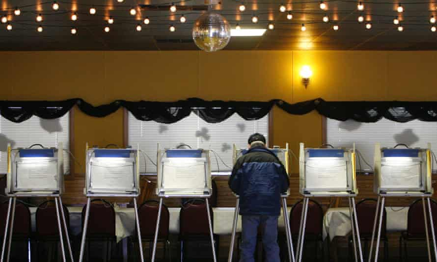 A voter casts his ballot at Country Keg & Pub Restaurant in Cedarburg, Wisconsin.