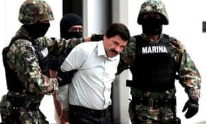 Mexican marines lead away Joaquín Guzmán after his arrest in February 2014.