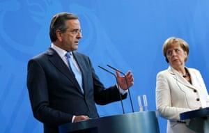 Greek prime minister Antonis Samaras and German chancellor Angela Merkel address a joint news conference in Berlin. Photo: Reuters/Fabrizio Bensch