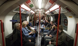View of passengers looking serious on a London tube train