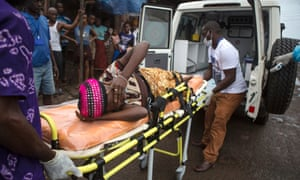 A pregnant woman suspected of contracting Ebola is lifted by stretcher into an ambulance in Freetown, Sierra Leone.