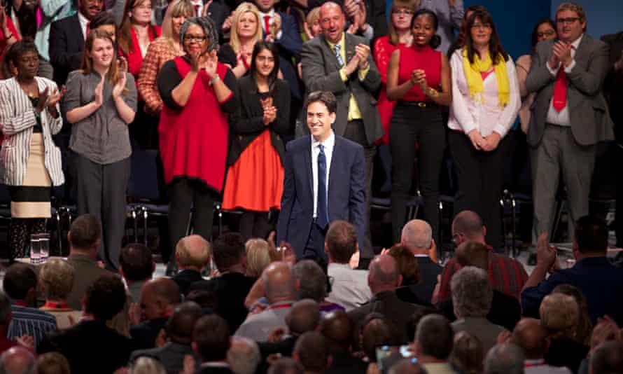 Labour leader Ed Miliband is applauded by party members at the end of his speech
