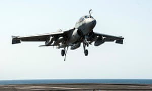 A US warplane Super Hornet lands on the aircraft carrier USS George HW Bush after taking part in strike missions against Islamic State targets in Syria