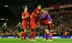 Liverpool goalkeeper Simon Mignolet celebrates with his team-mates after the penalty shoot-out.