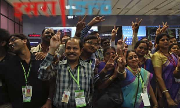 Indian Space Research Organisation scientists celebrate as the Mars mission successfully enters orbit.