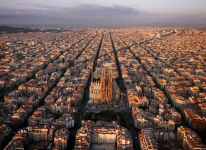 Barcelona, Spain: The Eixample district with the Sagrada Familia cathedral. The octagonal city blocks were designed to allow light and space on the street corners.