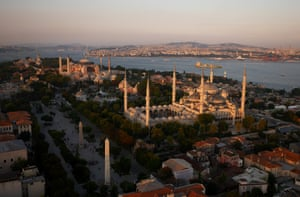 Istanbul, Turkey: Mosques dominate the skyline  as a freighter sails for the Sea of Marmara.