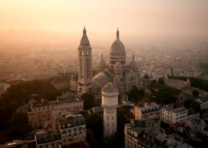 Paris, France:  Sacré-Cœur glowing in a hazy sunrise.