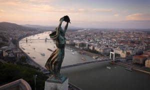 Budapest, Hungary: The windswept Liberty Statue, overlooking the city.